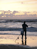 Sea fishing with a rod from the beach Royalty Free Stock Photography