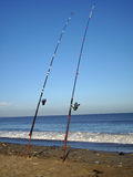 Sea fishing rods on beach Stock Photography