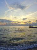 Sea fishing at sunset, amazing sky Stock Photography