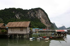 Sea fishing village. House of fisherman and boat. Ao Phang nga National Park. Koh Panyee. A Muslim sea gypsy fishing village stock photo