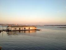 Sea Floating House Sun set royalty free stock photography