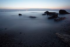 Sea with floating ice at sunrise in Odessa Ukraine. Royalty Free Stock Image