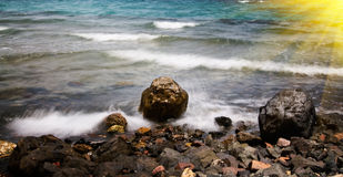 Sea Foam And Pebble In The Water. Royalty Free Stock Images
