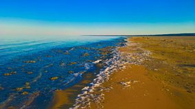 Sea foam at the beach of the Aral Sea near Aktumsuk cape at sunset, Karakalpakstan, Uzbekistan. Sea foam at the beach of the Aral Sea near Aktumsuk cape at Stock Images