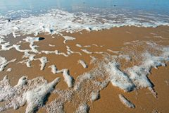 Sea foam at the beach. At the atlantic ocean Stock Photo