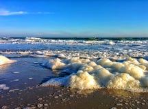 Sea foam and blue sky Stock Photo