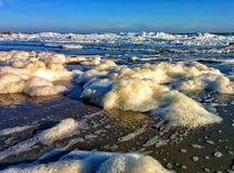 Sea foam and blue sky Royalty Free Stock Images