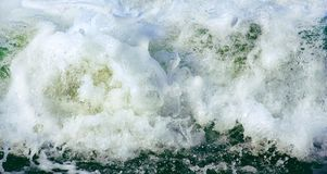 Sea foam frozen in motion as a background stock image