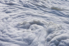 Sea foam pollution. Close up of sea foam spiral with striations and large bubbles Stock Image