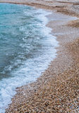 Sea foam on the shore Royalty Free Stock Images