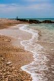 Sea foam on the shore landscape Stock Photo
