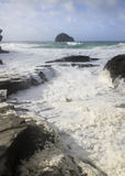 Sea foam at Trebarwith strand Stock Photography