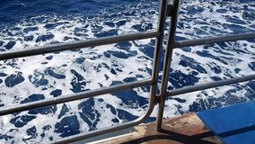 Sea foam and waves near a floating ship stock video