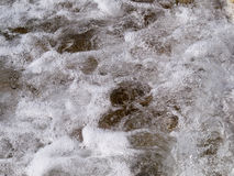 Sea foam Stock Images