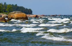Sea with foamy waves. Foamy waves in windy summer day rushing to shore in nice rhythm Stock Photography