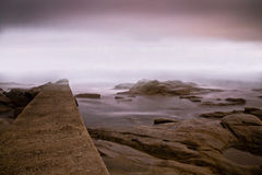 Sea and fog. Foggy evening at elba island in winter Stock Images