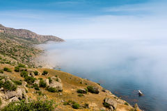 Sea and fog over water Stock Image