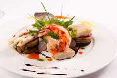 Sea food. With fish and prawns in a plate Stock Photos