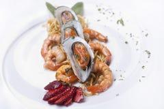 Sea food. Spaghetti with sea food onwhite background Stock Photography