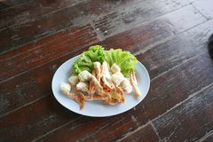 steam crab leg on dish stock images