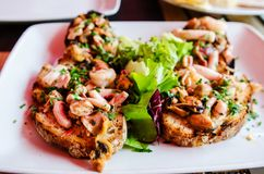 Sea food bruschettas Royalty Free Stock Images