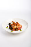 Sea food dish. Shrimps and mussels with tomatoes sauce and wasabi Stock Images