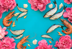 Sea food and flowers background Stock Photos