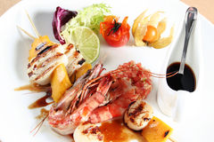 Sea food on gril Royalty Free Stock Images