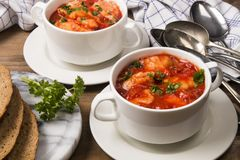 Sea food mix soup in a white bowl stock images