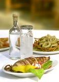 Sea food with ouzo. Ouzo spirit and sea food,greek food, sea food, calamaris, grilled calamaris Royalty Free Stock Photo