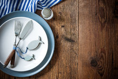 Sea food place setting on wooden table with copy space Royalty Free Stock Images