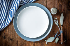 Sea food place setting on wooden table with copy space Stock Image