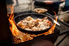 Sea food preparing on the fire Royalty Free Stock Photo