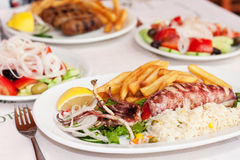 Sea food. With salad in the restaurant Royalty Free Stock Photography
