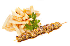 Sea food  skewers with french fries Royalty Free Stock Images
