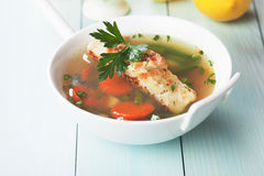 Sea food soup with cod fish steak Stock Photo