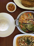 Sea food tom yum in pot, fry fish, Spicy fried razor clams  wit Stock Photos