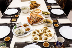Sea Foods on The Table such as Streamed Crab, Streamed Shrimps, Scallops, Mantis Shrimps and Oysters Stock Photo