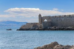Sea in foreground and part of the castle at Greek island Rhodes. Tropical sea background Royalty Free Stock Photos