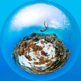 Sea in form of sphere. Panorama in the form of sphere of the lady freediver exploring the sea floor with corals Stock Photo