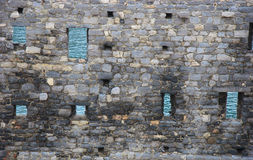 Sea through a fortification in Italy. Old fortification wall with the sea through the windows, Italy Royalty Free Stock Image