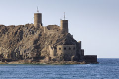 Sea fortifications at the entrance to Old Muscat Royalty Free Stock Photos