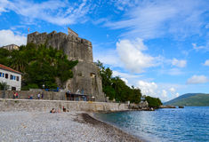 Sea Fortress (Forte Mare), Herceg Novi, Montenegro. HERCEG NOVI, MONTENEGRO - SEPTEMBER 25, 2015: Unidentified people are relaxing on the beach near the Sea stock images