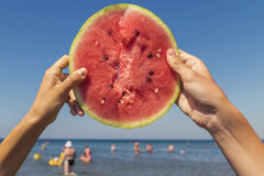 Sea, friendship and watermelon Stock Photos