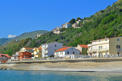 Sea front houses. A landscape photo of a coastal village with houses on the sea front and high in the hills above Stock Photo