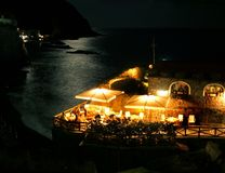 Sea front restaurant by night. Sea front restaurant in a bay, night view, sea lighten by the moon Stock Photo