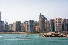 Sea front view with luxurious buildings in Abu Dhabi Royalty Free Stock Image