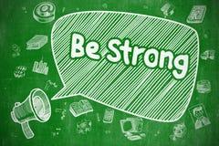 Sea fuerte - ejemplo de la historieta en la pizarra verde Foto de archivo