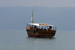 On the sea of Galilee. Tourists floating on a boat on the sea of Galilee stock photo
