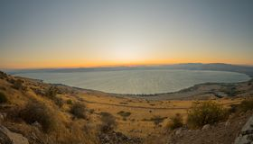 Sea of Galilee the Kinneret lake, at sunset. Panoramic view of the Sea of Galilee the Kinneret lake, from the east, at sunset, Northern Israel Stock Image